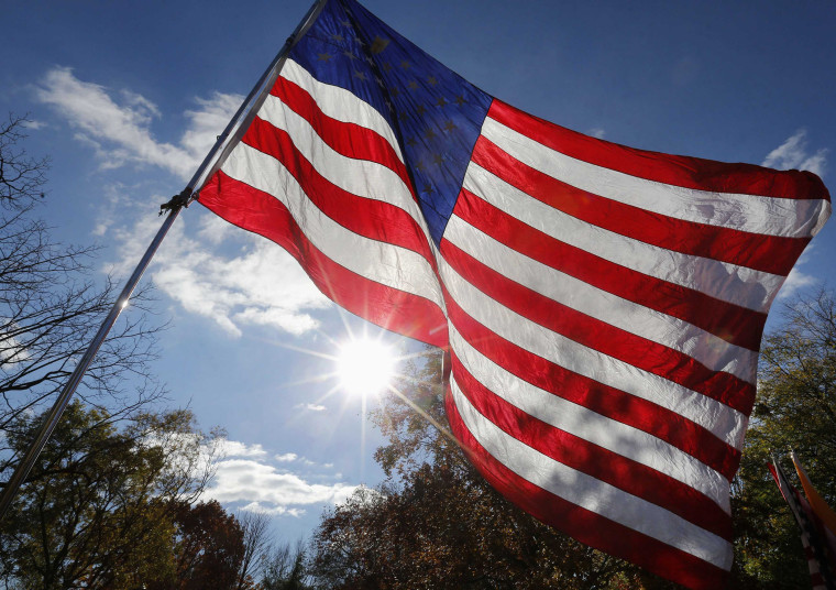 An American flag is seen during a protest in Lafayette Park, across the street from the White House in Washington, November 19, 2013.