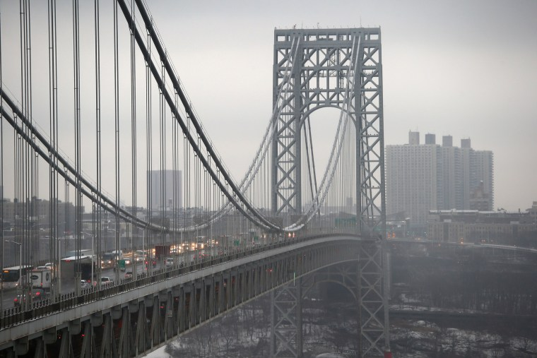 Traffic moves over the Hudson River and across the George Washington Bridge between New York City (R), and in Fort Lee, New Jersey on December 17, 2013.
