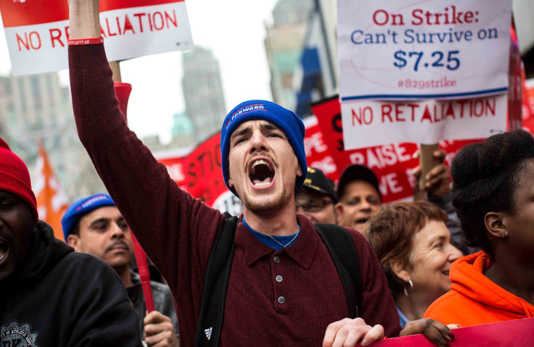 Protesters rally outside of a Wendy's in support of raising fast food wages from $7.25 per hour to $15.00 per hour on Dec. 5, 2013 in the Brooklyn borough of New York City.