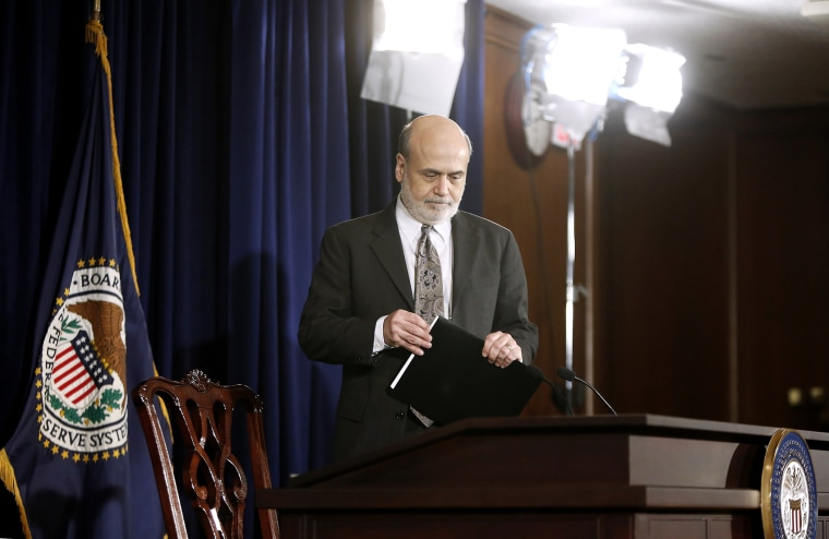 U.S. Federal Reserve Chairman Ben Bernanke takes his seat for a news conference at the Federal Reserve Bank headquarters in Washington, Dec. 18, 2013.