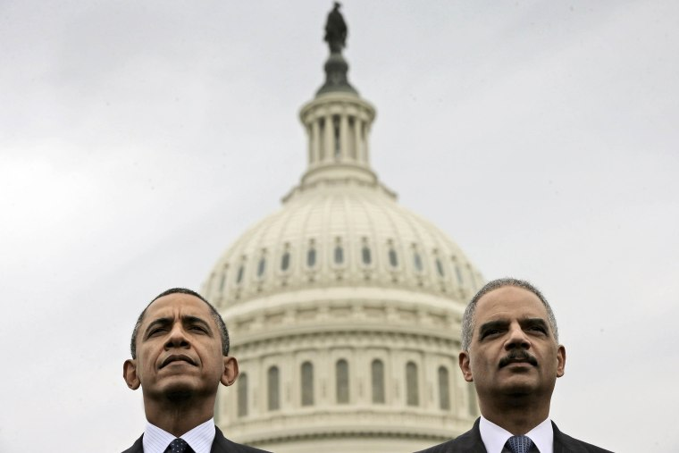 Barack Obama sits with Attorney General Eric Holder during the 32nd annual the National Peace Officers Memorial Service, May 15, 2013, on Capitol Hill in Washington, honoring law enforcement officers who died in the line of duty.