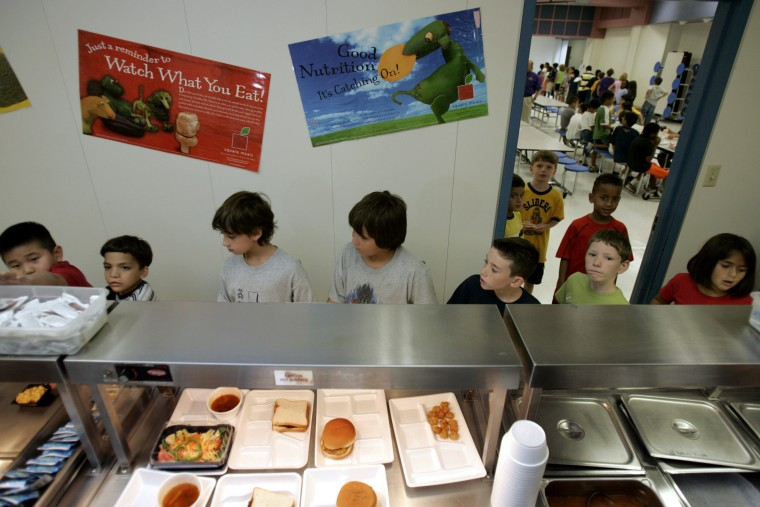Children from McKamy Elementary School in Carrollton, Texas select food from the school cafeteria, Friday, Aug. 19, 2005.