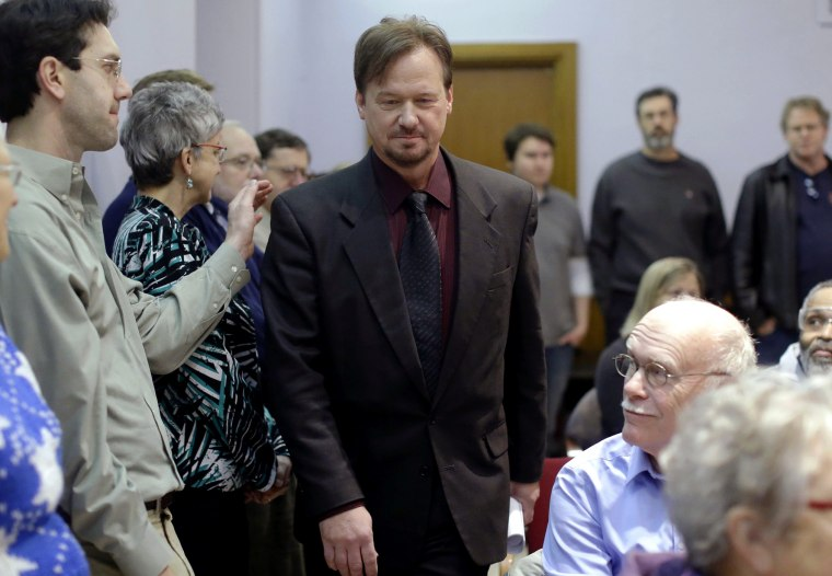 A man places a hand on the shoulder of The Rev. Frank Schaefer, a United Methodist clergyman convicted of breaking church law for officiating at his son's same-sex wedding, as he enters a news conference, Dec. 16, 2013, at the Arch Street United Methodist