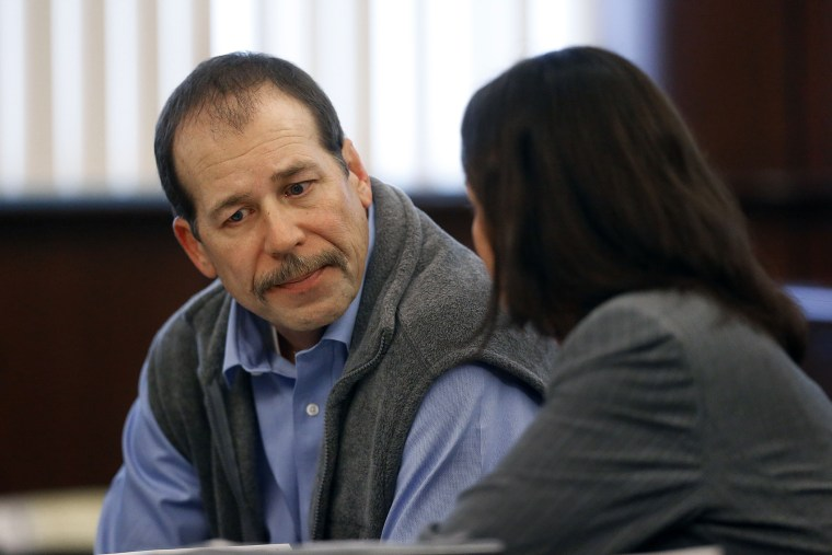 Theodore Wafer listens to his attorney Cheryl Carpenter while appearing at his preliminary examination before District Court Judge David Turfe in Dearborn Heights, Mich., Dec. 18, 2013.