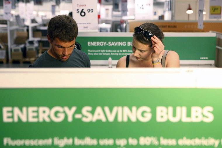 Joe Mozloom and Allison Roethke shop for compact fluorescent bulbs at an Ikea store in Philadelphia, Tuesday, June 15, 2010.