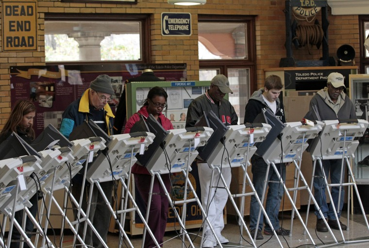 People vote at a polling site at the Toledo Police Museum for the 2012 presidential election in Toledo, Ohio, November 6, 2012.