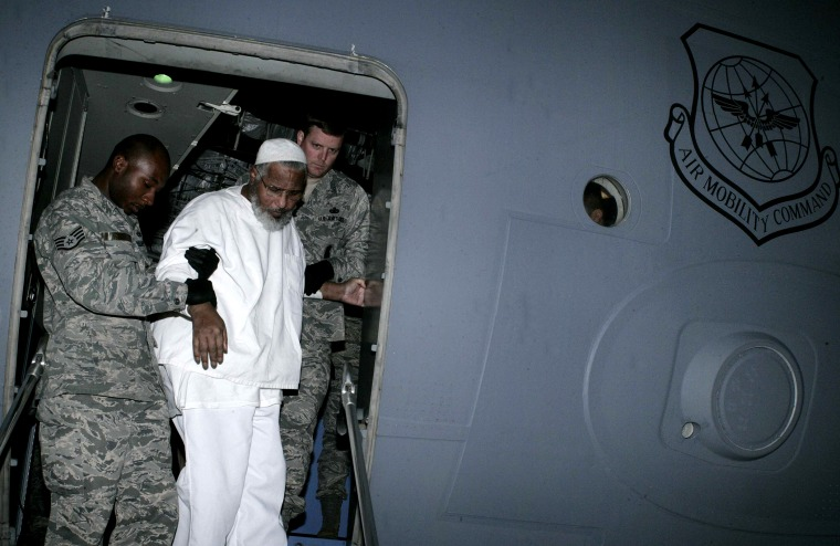 US soldiers help Sudanese Guantanamo prisoner Ibrahim Othman Ibrahim Idris exit a US military plane at Khartoum airport following his release from the Cuba-based US prison on Dec. 19, 2013.