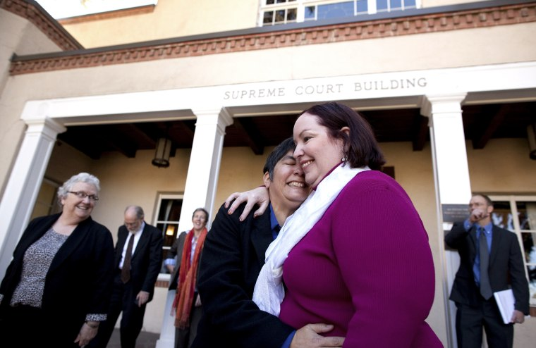 Plaintiffs Rose Griego, left, and Kim Kiel hug outside the New Mexico Supreme following a hearing on same-sex marriage in Santa Fe, N.M., Oct. 23, 2013.