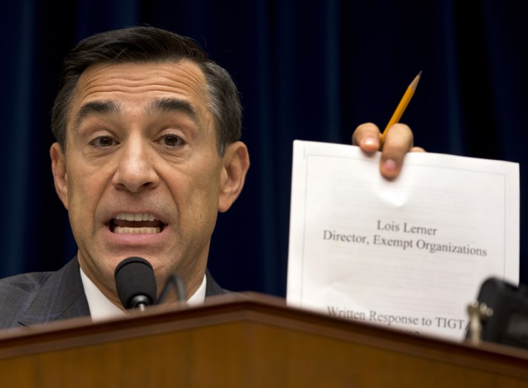 House Oversight Committee Chairman Rep. Darrell Issa, R-Calif. holds up a document as he speaks on Capitol Hill in Washington, Wednesday, May 22, 2013.