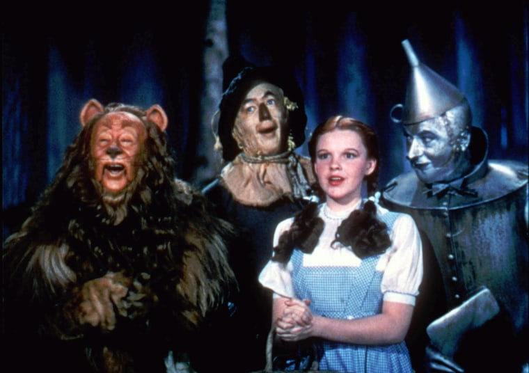 """This 1939 file photo provided by Warner Bros. shows, from left, Bert Lahr as the Cowardly Lion, Ray Bolger as the Scarecrow, Judy Garland as Dorothy and Jack Haley as the Tin Woodman in a scene from """"The Wizard of Oz."""""""