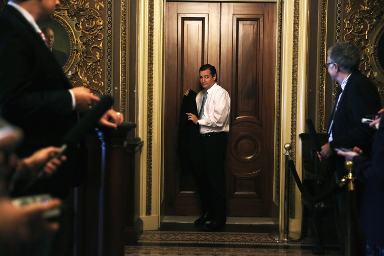 Sen. Ted Cruz (R-TX) leaves after the weekly Senate Republican Policy Committee luncheon, Sept. 24, 2013 on Capitol Hill in Washington, DC.