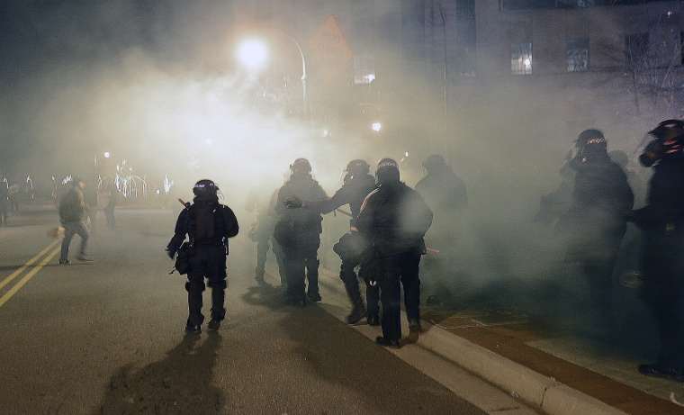 Officers in riot gear respond to a protest of the death of 17-year-old Jesus Huerta who died in police custody on Dec. 19, 2013, in Durham, N.C.