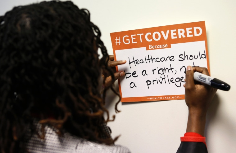 A woman fills out her thoughts on the Affordable Care Act at the White House Youth Summit on the Affordable Care Act in Washington, December 4, 2013.