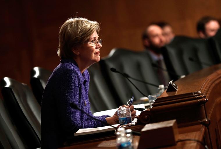 Sen. Elizabeth Warren (D-MA) listens as Consumer Financial Protection Bureau Director Richard Cordray testifies before the Senate Banking, Housing and Urban Affairs Committee, Nov. 12, 2013 in Washington, DC.