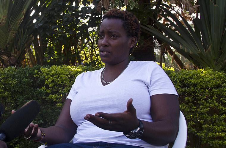 Gay rights activist Clair Byarugaba talks to journalists in Kampala on December 20, 2013.