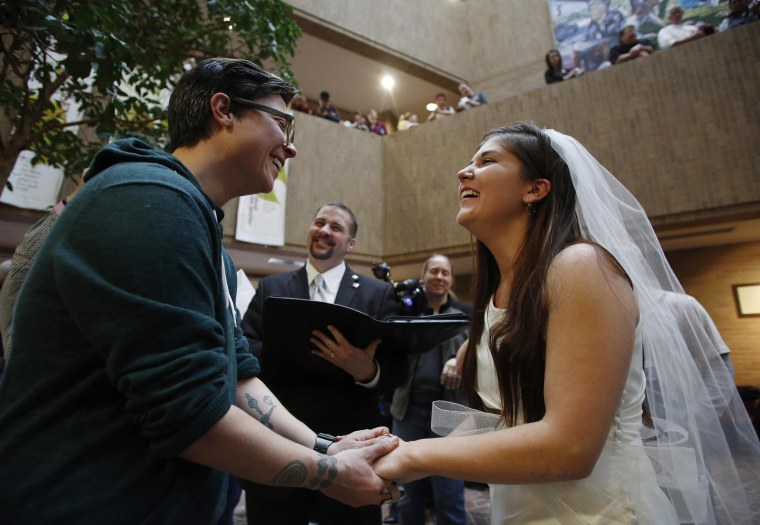 Jax Collins (L) and Heather Collins get married at the Salt Lake County Government Building in Salt Lake City, Utah, December 23, 2013.
