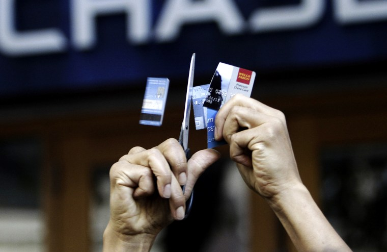 Occupy Seattle protesters cut up bank cards in from of a Chase bank in downtown Seattle, October 15, 2011.