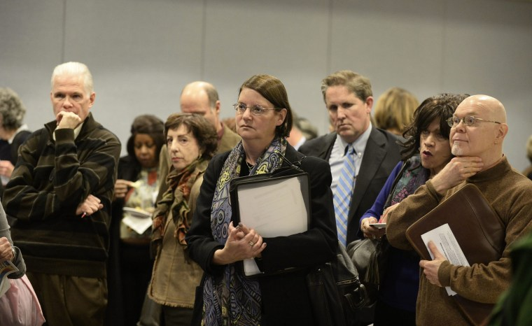 Potential job seekers speak with employers at a job fair in New York, New York, November 20, 2013..
