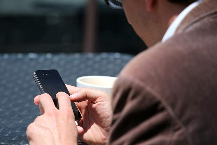 A man uses a smartphone in San Francisco, Calif., June 5, 2013.