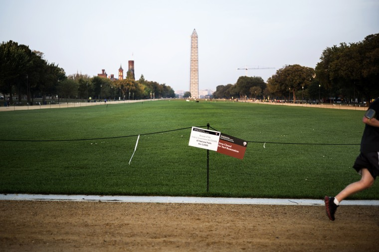 A man runs through a closed National Mall in Washington, DC, Oct 3, 2013.