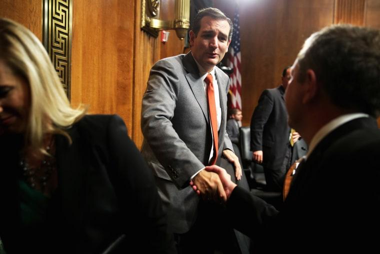 Sen. Ted Cruz shakes hands with David Barron after his nomination hearing, Nov. 20, 2013.