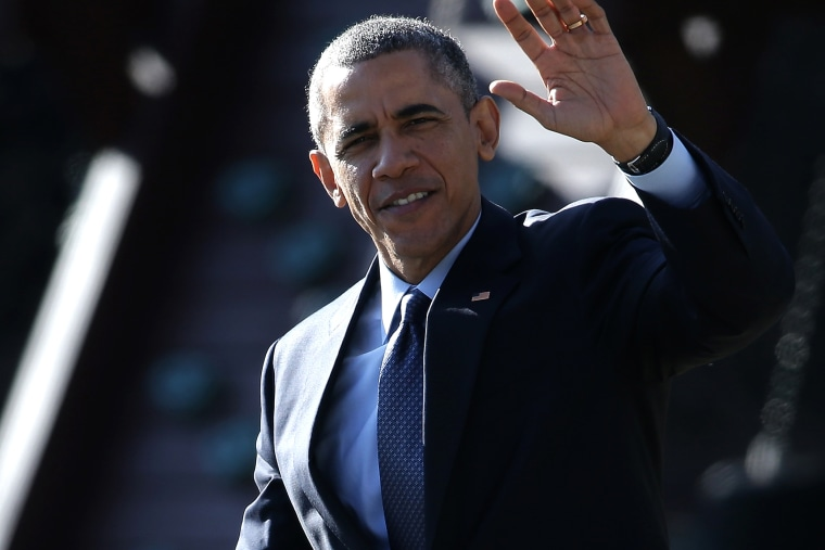 U.S. President Barack Obama waves as he departs the White House on Dec. 15, 2014 in Washington, DC.
