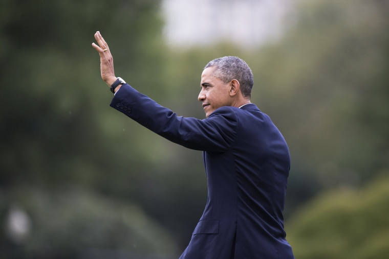 President Barack Obama waves as he walks across the South Lawn of the White House in Washington on Oct. 7, 2014. (Carolyn Kaster/AP)