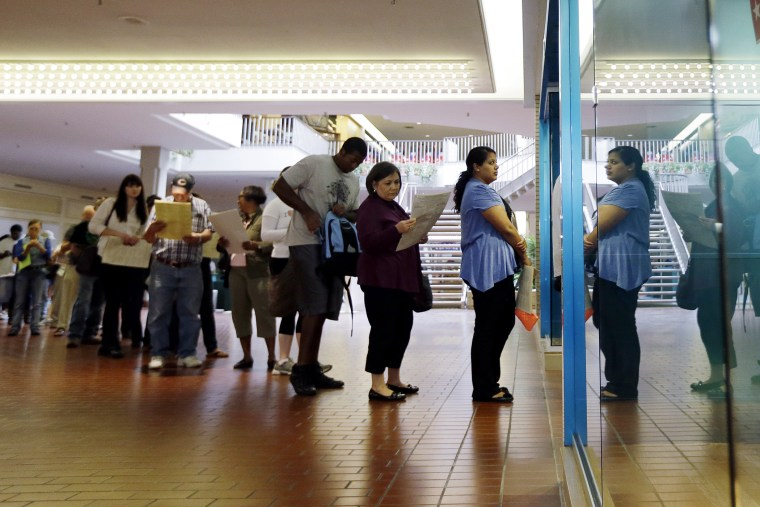 Voters wait in line at a polling place located inside a shopping mall, on Election Day on Nov. 6, 2012, in Austin, Texas. (Eric Gay/AP)
