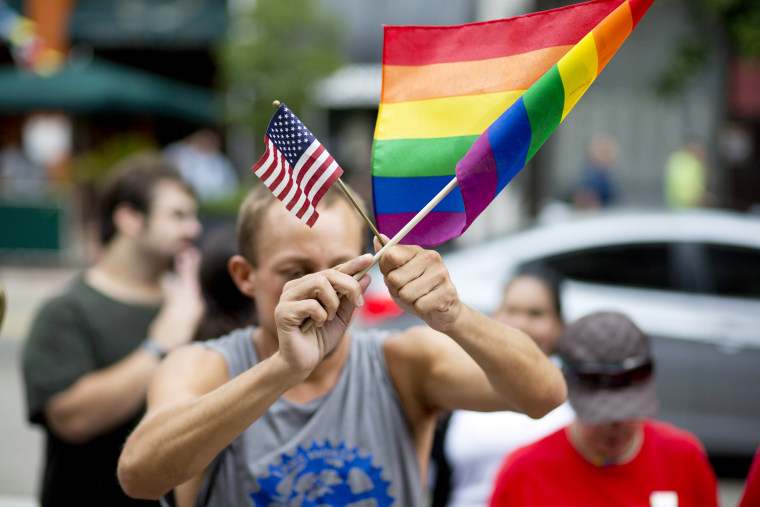 A man demonstrates outside the Miami court house during the court hearing on gay marriage in Miami, Fla. on July 2, 2014. (J Pat Carter/AP)