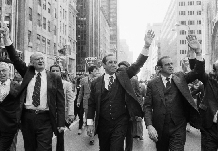 Marching down New York's Fifth Avenue during Columbus Day Parade, in New York, Oct. 11, 1982, are from left Congressman Mario Biaggi, New York City...