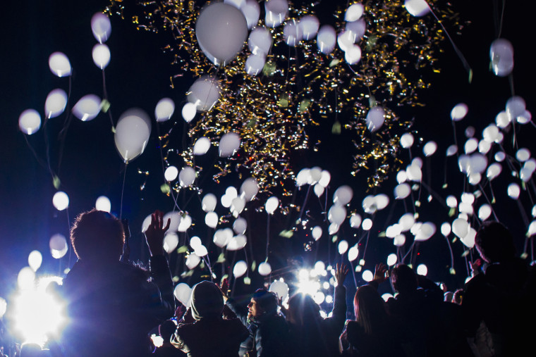 People release balloons during New Year celebrations in Tokyo