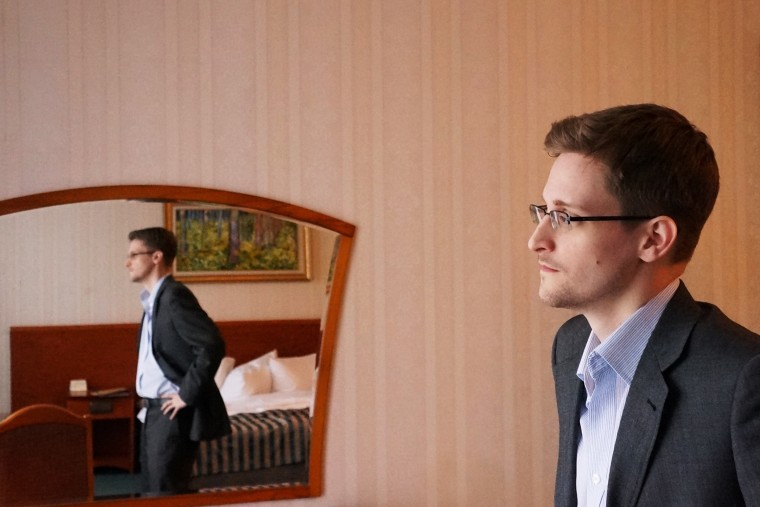 Former intelligence contractor Edward Snowden poses for a photo during an interview in Moscow, Dec. 2013.