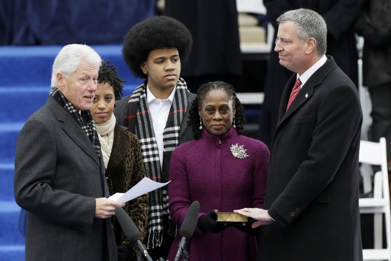 Former President Bill Clinton, left, speaks before he administers the oath of office to Mayor-elect Bill de Blasio, Jan 1, 2014.