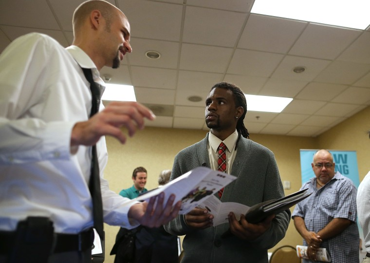 A job seeker meets with a recruiter during the East Bay's HIREvent on Oct. 8, 2013 in Emeryville, Calif.