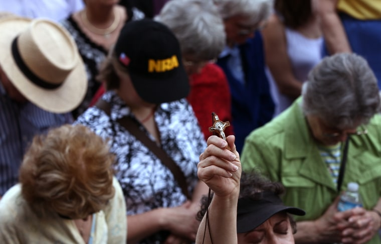 """Protesters pray while participating in a """"Stand Up for Religious Freedom"""" rally in front of the Department of Health and Human Services on Friday in Washington, D.C."""
