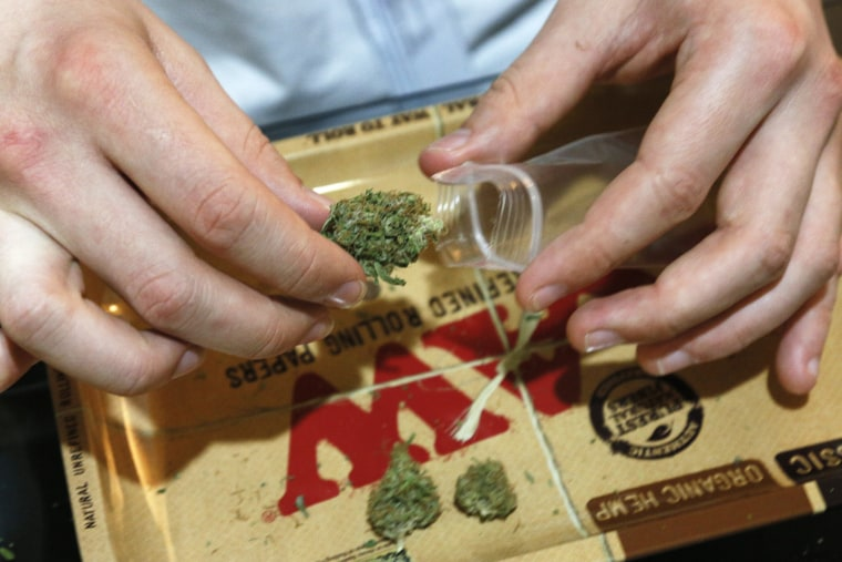 Marijuana buds are packaged for sale at the Botanacare marijuana store ahead of their grand opening in Northglenn, Colorado Dec. 31, 2013.