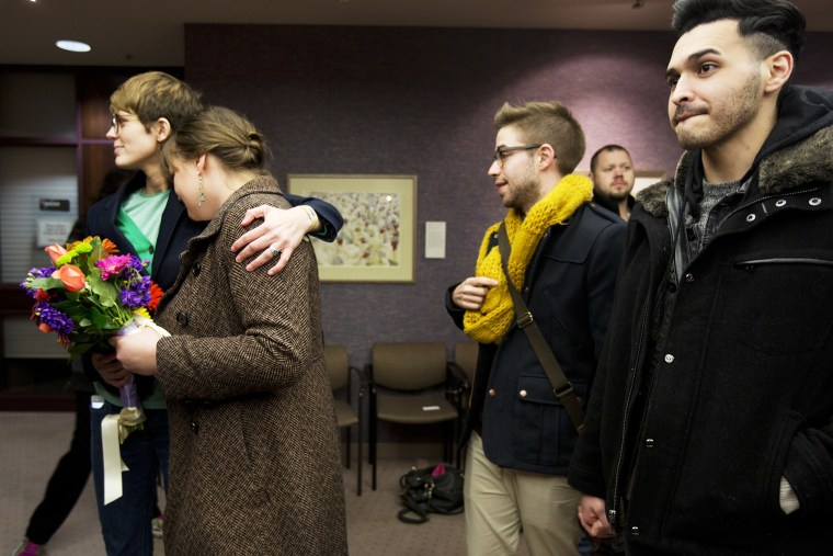 Same-sex couples wait in line to get a marriage license at the Salt Lake County Clerk's Office, Dec. 20, 2013.