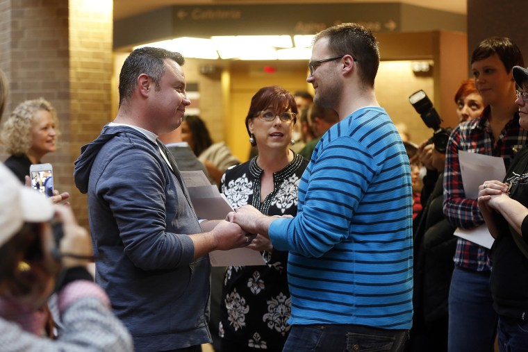 Isaac Troyo and his partner Jed Mecham get married at the Salt Lake County Government Building in Salt Lake City, Utah, Dec. 23, 2013.