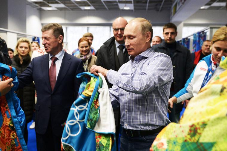 Russian President Vladimir Putin tries on a Sochi jacket, Jan. 4, 2014.