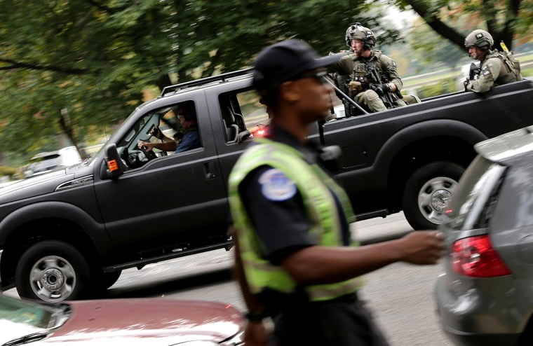 FBI agents in SWAT gear respond to an incident on Constitution Avenue outside the U.S. Capitol Oct. 3, 2013 in Washington.