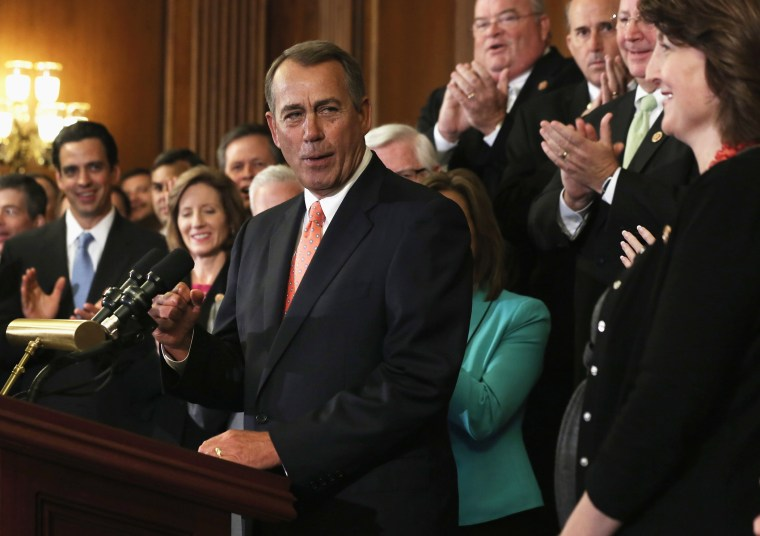 Speaker of the House Rep. John Boehner (R-OH) celebrates as he speaks during a rally as other House Republicans look on after a vote September 20, 2013 on Capitol Hill in Washington, D.C.