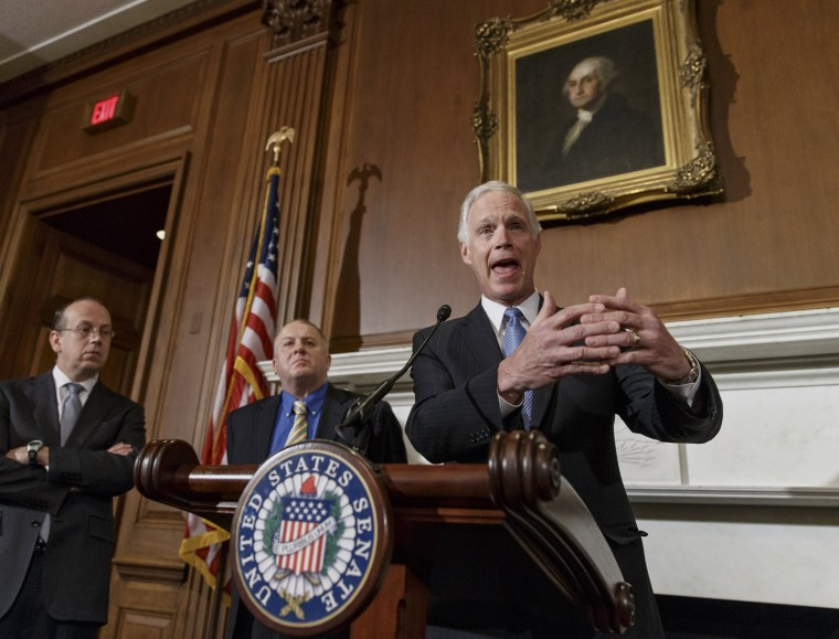 Sen. Ron Johnson, R-Wis., joined by attorneys Paul D. Clement, far left, and Rick Esenberg, second from left, announces that he has filed a lawsuit to block the federal government from helping to pay for health care coverage for members of Congress and th
