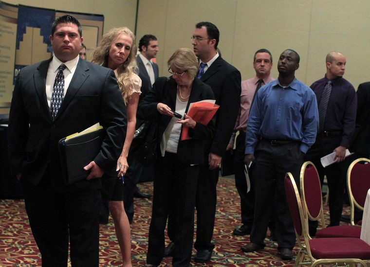 People wait in line to meet with recruiters during a job fair in Melville, New York July 19, 2012.