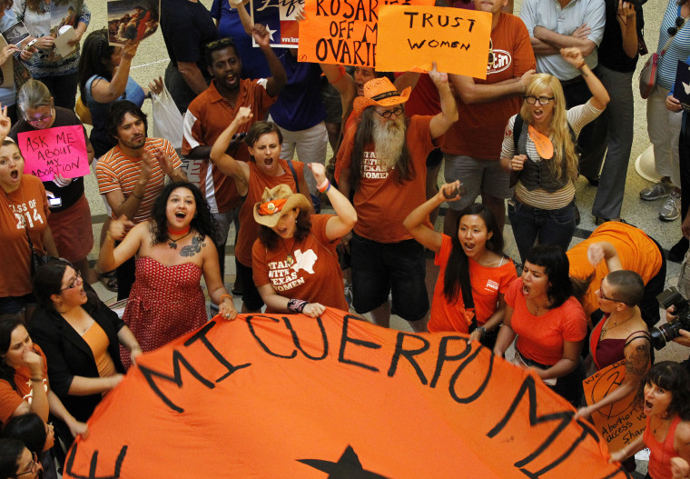 Protesters rally in the rotunda of the State Capitol as the state Senate meets to consider legislation restricting abortion rights in Austin, July 12, 2013.