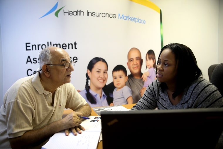 Narendra Parmar sits with Certified Enrollment Specialist, Laquanda Jordan, as he finishes the process of picking and signing up for health insurance in Miami, Dec. 23, 2013.