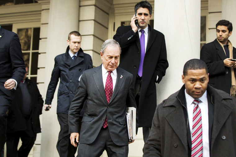 New York City mayor Michael Bloomberg departs City Hall, Dec. 19, 2013.