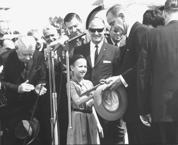 President Lyndon B. Johnson (3R) w. Girl Scout (C) during 6 state poverty tour and w. Gov. Frank C. Clement (R) and Franklin D. Roosevelt (L) on May 1, 1964.