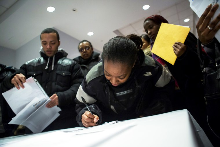 People attend a job training and resource fair at Coney Island in New York December 11, 2013.