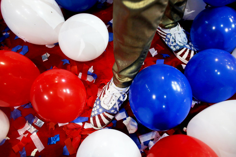 A person stands in balloons at the Republican National Convention in Tampa, Aug. 30, 2012.