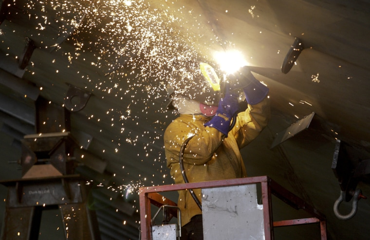 Vigor Industrial employee welds metal on a ferry being built for Washington State Ferries at the company's Harbor Island centre in Seattle